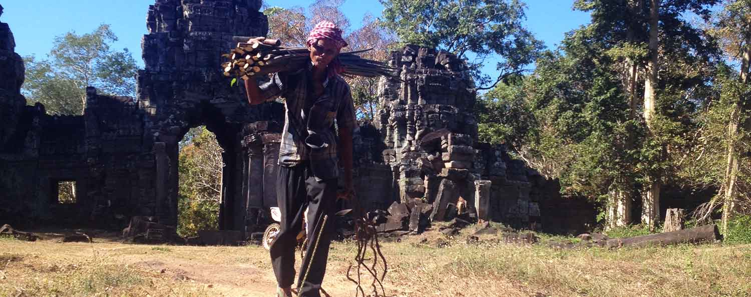 Old man carrying wood infront of Preah Khan temple