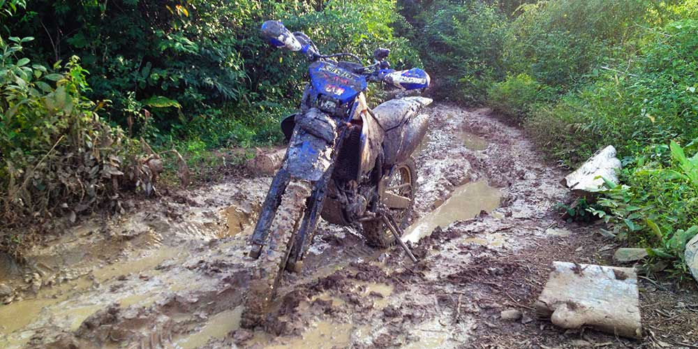 Muddy, rutted section on the way to Preah Khan... WR covered in mud