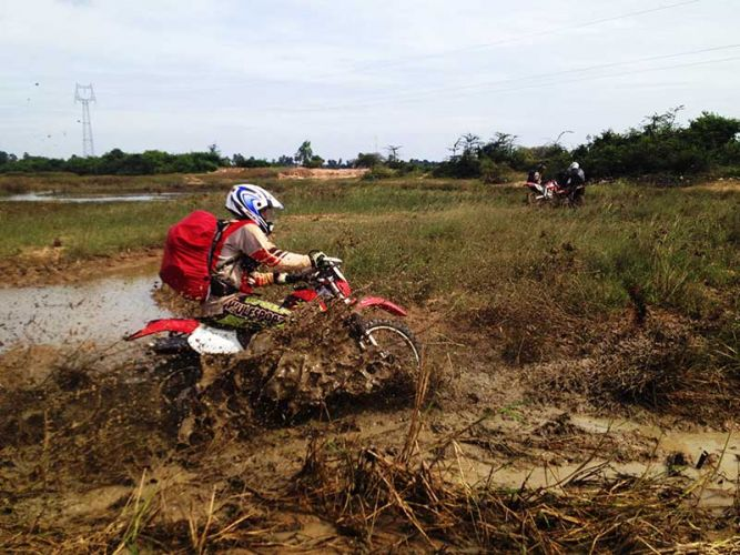 dirt-bike-tours-cambodia-muddy-fields