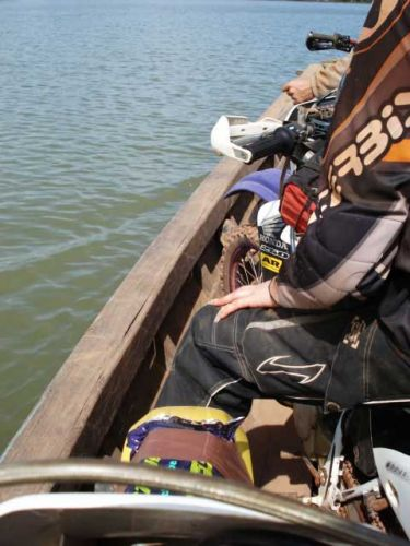 dirt-bike-tours-cambodia-boat