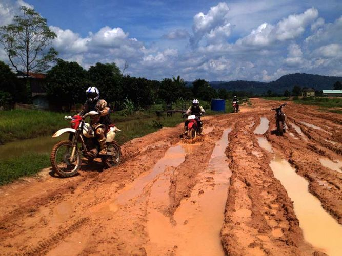 dirt-bike-tours-cambodia-muddy-ruts